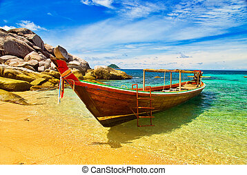 Longtail Boat in Turqouise Bay - Thai Longtail Boat Anchored...