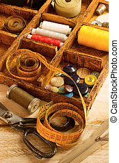 sewing tools - Sewing tools in a wooden box on a table