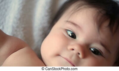 5-month girl is smiling - Little 5-month baby girl is...