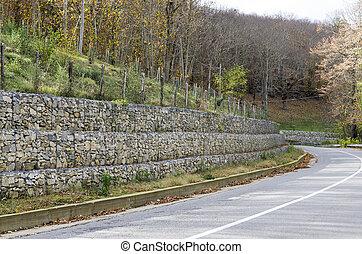 retaining wall gabion - retaining drywall, built of stone...