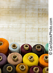 bobbins - colourful bobbins on a wooden surface