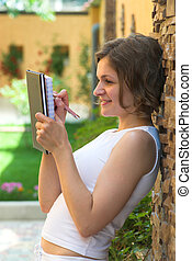 Writing in diary - Dreaming girl is writing notes in her...
