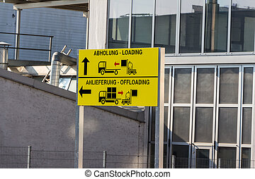 sign pickup and delivery - a sign shows the different gates...