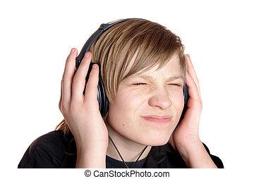teenager in ear-phones - teenager in earphone listens music...
