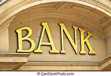 Bank building sign - Gold Bank sign at the entrance to a...