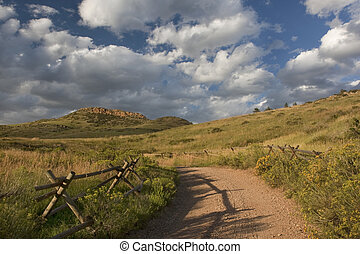 dirt road in Colorado at foothills of Rocky Mountains - dirt...