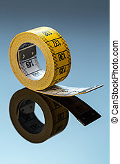 yellow tape measure, symbolic photo for diet control and...