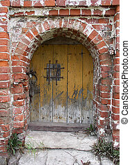 old door - An old wooden door in brick wall