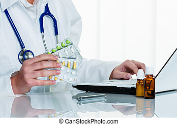 doctor writes a prescription for tablets
