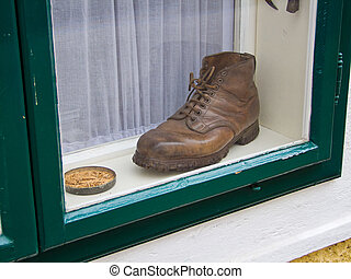 old shoe - an old shoe in a window