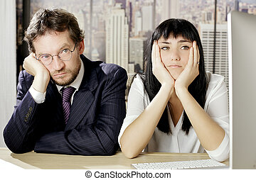 Unhappy business people sitting on desk depressed - Sad...