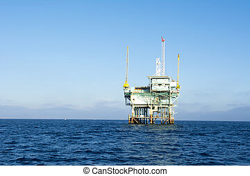Offshore oil platform - An offshore oil platform rests in...