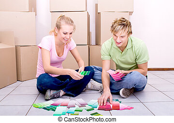 newlyweds in new home - lovely newlyweds deciding how to...