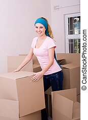 woman busy moving home - a pretty woman busy moving home and...