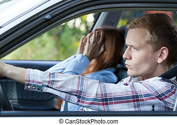Couple arguing in a car - Young people having a fight while...