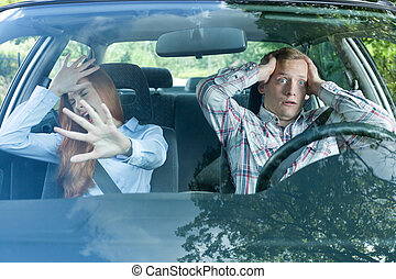 Young couple just before accident - Couple in a car about to...