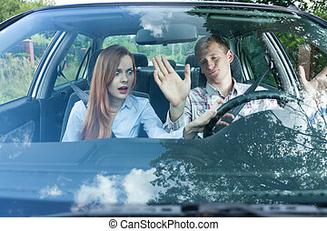 Couple having argument in car