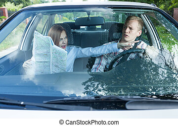 Couple fighting over driving directions - Young couple...