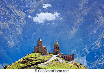 Church on high mountain - Gergeti christian church near...