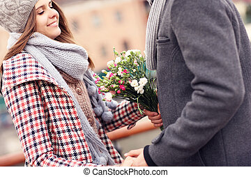 Romantic couple on a date with flowers