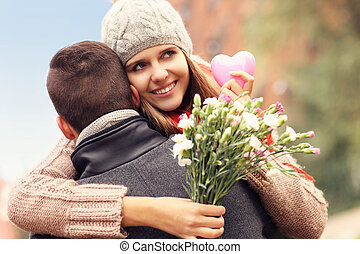 Beautiful woman with Valentines gift and flowers