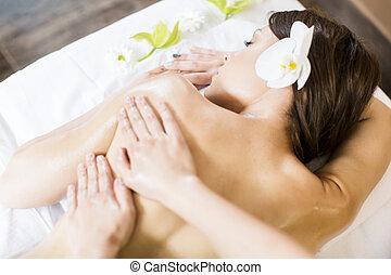 Massage - Pretty young woman having a massage