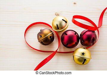 Jingle bells - Multicolor jingle bells with red ribbon.