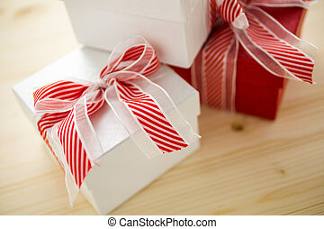 Chtistmas gifts - Red and white boxes with Christmas gifts