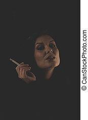 Sensual brunette smoking, snuff smoke addiction