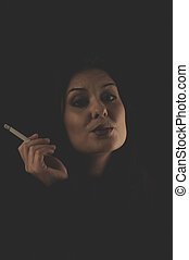 Sensual brunette smoking, snuff smoke addiction