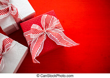 Chtistmas gifts - Red and white boxes with Christmas gifts.