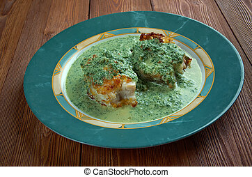 Merluza en salsa verde - fried fish with green sauce