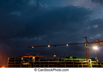 Constraction site with a crane at night