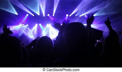 Crowds at open air rock festival - Low angled view from the...