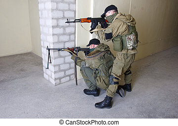 insurgents with gun - insurgents with AK 47 and gun inside...