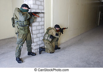 insurgents with AK 47 inside the building