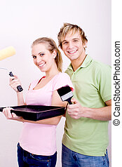 DIY couple - a DIY couple posing together and smiling with...
