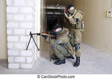 insurgents with AK 47 and gun inside the building