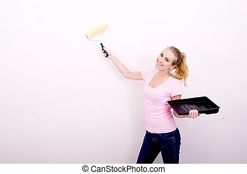 interior designer - an interior designer painting the wall a...