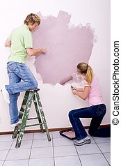 couple painting room - a casual couple on ladder and floor...