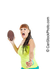 cute pretty girl in green shirt throws brown rugby ball towards