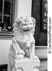 stone lion - white stone lion at chinese temple,Thailand