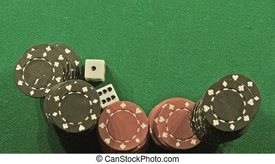 Rolling the dice - Two rolling white dice on casino table -...