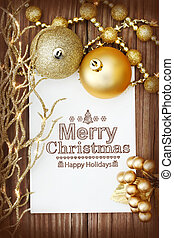 Merry Christmas message - Christmas ornaments on wooden...