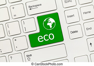 White conceptual keyboard - Eco green key with world icon -...