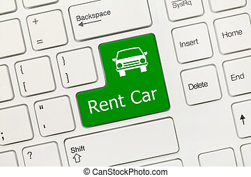 White conceptual keyboard - Rent car green key - Close up...