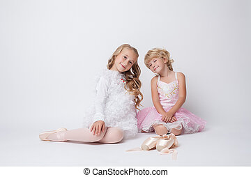 Lovely little ballerinas posing in studio - Image of lovely...
