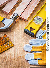 set of construction tools on wooden board