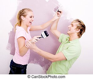 joking couple painting - a couple joking around painting...
