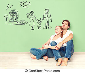 concept. young couple dreaming of new house, car, child,...